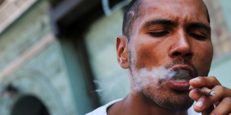 Man smoking a joint. 4 Things We Wish We Could Say To People That Are Anti-Pot.