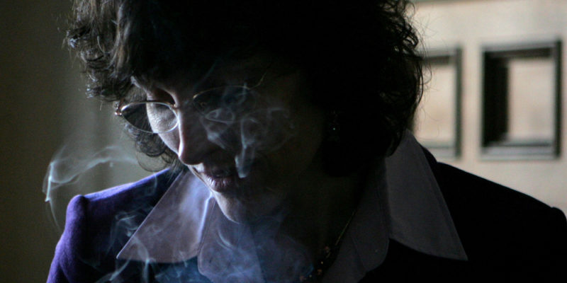 Older woman smoking cannabis