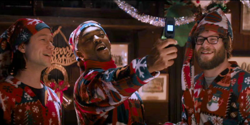 A screenshot from the Night before of the three male actors in christmas onesies